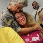 Dr. Riki Ott consoles a woman affected by the Gulf Horizon oil spill